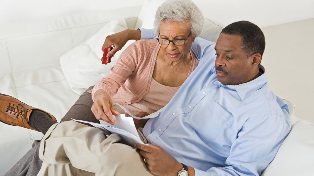 Senior couple work out their finances for aging in place succesfully