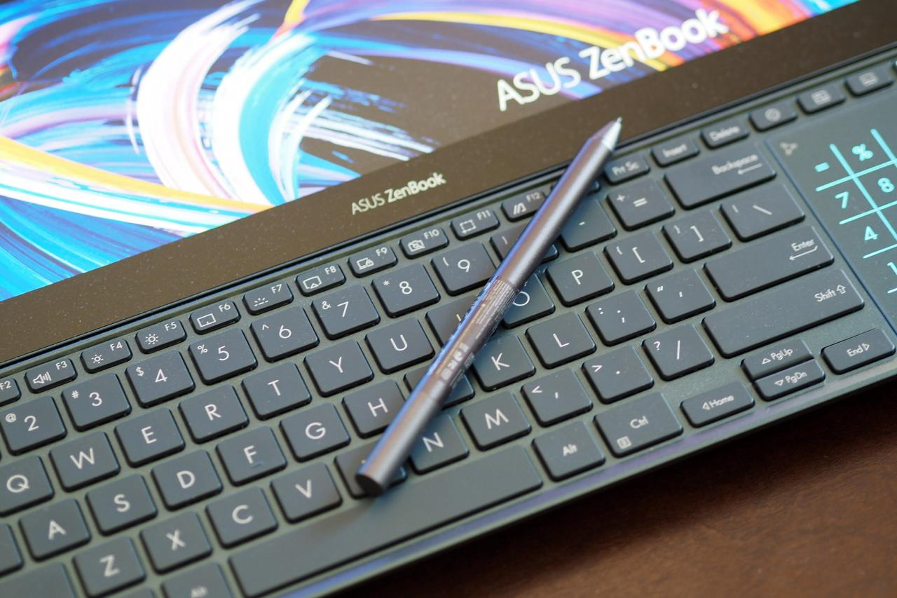 Asus ZenBook Pro Duo 15's keyboard with stylus sitting on top.