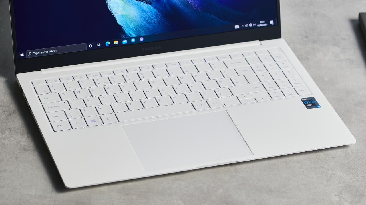 Samsung Galaxy Book Pro on wooden table and close up on the keyboard and touch pad