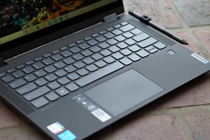 Image of the Lenovo IdeaPad Flex 5i 14, showing the keyboard, trackpad, and stylus.